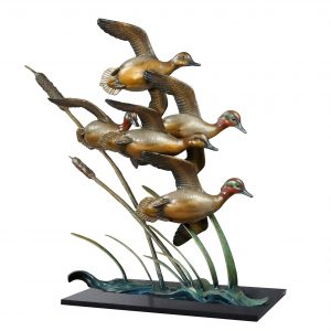 against the wind green wing teals bronze caswell sculpture