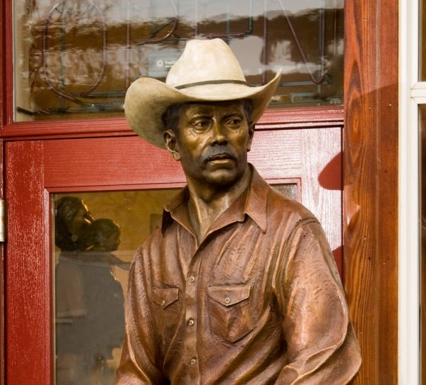 corral companions, caswell sculpture, rip caswell, alison caswell, bronze cowboy, dog, brass, figure, life-size, monument, figurative, western, jackson hole, wyoming, cody wyoming, wild west, montana, metal, art, statue, statuary, wrangler, corral, ranch, texas