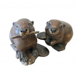 Business partners beavers sculpture